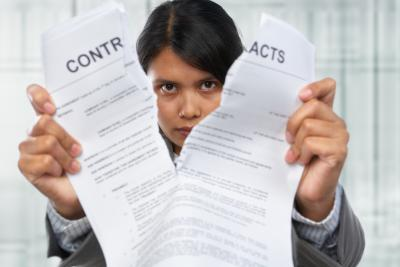 Women ripping up contract