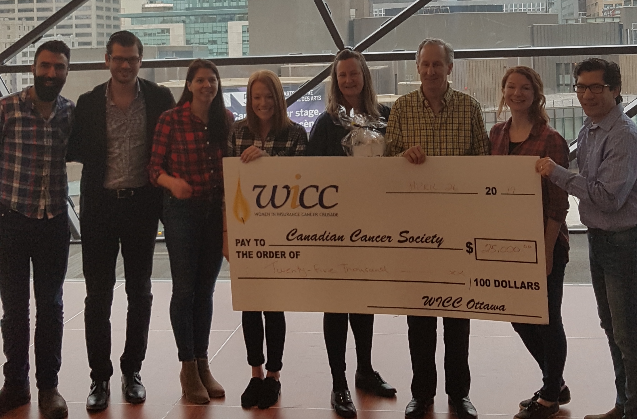 Group holding check at Wicc breakfast 2019